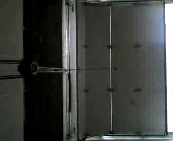 Puewrta de garaje con puerta peatonal incertada